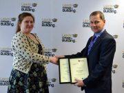 Deputy principal Derek Whitehead congratulates double award winner Elise Brewster from Leeds College of Building.