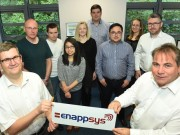 EnAppSys directors Phil Hewitt (front left) and Paul Verrill (front right), with their growing team of energy sector analysts