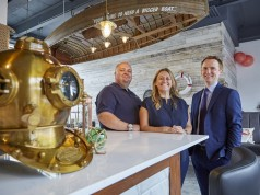 Owners James and Paula Stockdale with Wykeland Beal's Tom Watson, right, at the new Humber Fish Co. restaurant, the latest venue opening in Hull's Fruit Market waterfront quarter.