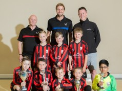 Tim Krul (centre, rear), Galliford Try Partnerships North's Phil Hunter (right, rear) and club founder Phil Gibson (left, rear) with the Killingworth team in their new kit