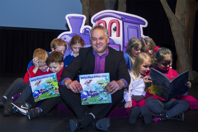 Author Peter Barron with children from Cockfield and Green Lane primary schools at the launch of Darly's Magical History Ride